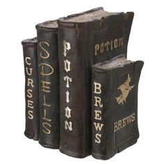 Halloween Decorations: Witch's Spell Books - These are made of polyresin but I wonder if you could make them out of old books from the thrift store.