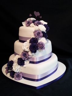 3 tier heart shaped wedding cake. roses cascading down with a purple theme....