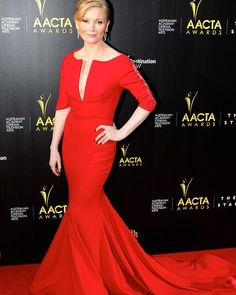 Essie Davis wears Leah Da Gloria with an Armani bag and Givenchy shoes at the AACTA Awards in Sydney.