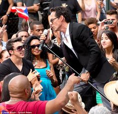 Living His Life: the passionate singer took command the microphone as he gave his fans and the music video his all...Nyc East Harlem