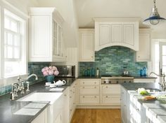 love the turquoise backsplash