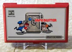 Vintage Nintendo Safebuster Game & Watch, Electronic Handheld Game, Model JB-63, Made in Japan, Copyright 1988.