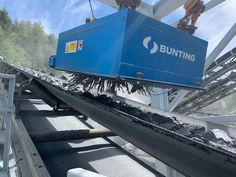 An action photo! A permanent Suspended Magnet in operation removing tramp ferrous metal from conveyed quarried rock #quarrying #Mining Bunting, Magnets, Around The Worlds, Action, The Unit, Rock, Metal, Garlands, Group Action