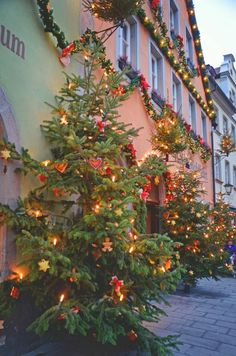 Rothenburg ob der Tauber, Germany - Christmas decorations at the side-by-side entrances of the wonderful original location of the Käthe Wohlfahrt Christmas Store and the Christmas Museum. There's also a Doll and Toy Museum nearby in Rothenburg.