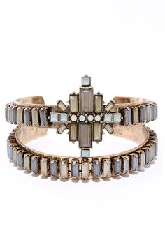"""Bedeck yourself in a design worthy of attention, like the Deco-ed Out Gold and Grey Rhinestone Bracelet Set! A set of two antiqued gold bands are embellished with faceted square gems, while an art deco motif decorates the center. Bracelet has a 2.5"""" diameter."""