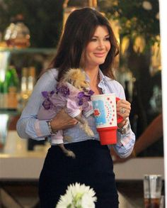 Lisa Vanderpump toted around her dog Giggy in Beverly Hills, California, on Aug. 17, 2015.