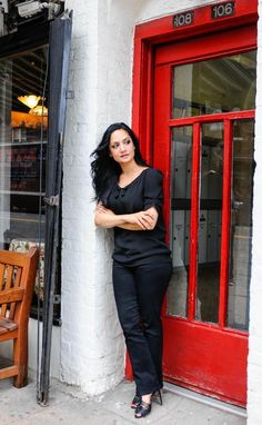 Archie Panjabi, dressed casual chic, outside Tea & Sympathy.