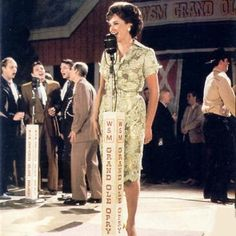 """Jessica Lange lip syncing in the movie """"Sweet Dreams"""" Patsy Cline biopic which was more fiction than fact.. In this seen Jessica is standing at the original spot at the old Ryman Auditorium where Patsy and other country legends performed.."""