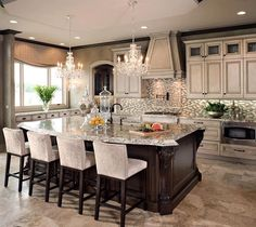 Beautiful kitchen design very classy with the dark to creamy white shades, beautiful for a newly designed house for a more homely feel towards the room