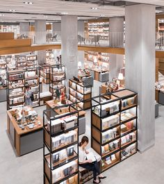 Kokaistudios designed for Alt-Life Bookstore in Ningbo celebrates space fluidity and variety, organic geometries and the notion of circulation as a. Public Library Design, Bookstore Design, Library Cafe, Retail Interior, Cafe Interior, Interior Design, Pharmacy Design, Retail Design, Library Architecture