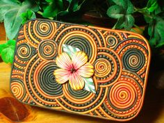 This one-of-a-kind box was created with polymer clay applied to a tin box