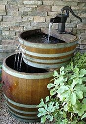 "Going on my husband's ""honey do"" list. Oak barrel water fountain"