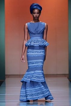 Traditional blue Shweshwe fabric, much loved in South Africa, in outfit designed by Bongiwe Walaza. For fascinating history of this textile,...