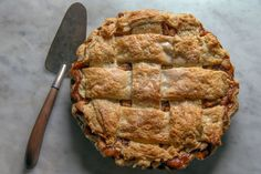 No matter where you bake it, this particular apple pie recipe is a keeper. Gently spiced with cinnamon, tinged with brown sugar and loaded with apple butter, it's as deeply flavored as an apple pie can be, all covered with a buttery wide-lattice top crust. (Photo: Fred R. Conrad/The New York Times)