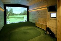 Amazing indoor golf simulator in Minnesota. You'd have to hit a lot of golf balls to get a good workout in here, but this golf simulator isn't really about breaking a sweat. Instead, it offers the fun of golf without the walking. Man Cave Designs, Building Design, Building A House, Build House, House 2, Home Golf Simulator, Indoor Mini Golf, Best Man Caves, Golf Room
