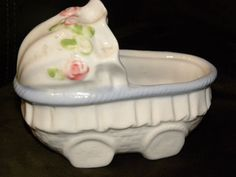 Another shabby chic nursery find. Small porcelain baby buggy with roses. Paid .50 at Goodwill