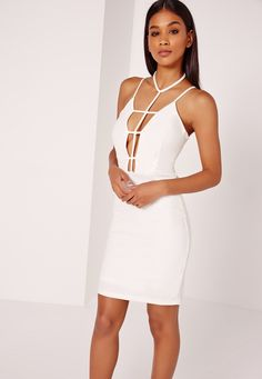We're loving all things harness here at mghq, so get the look in this ballin' bodycon dress. In all white, with harness neck detail, pair with heels and a clutch for night time vibes.