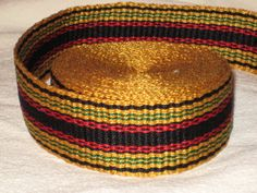 Gold, black, red, and green hand woven inkle trim (over 14 feet)