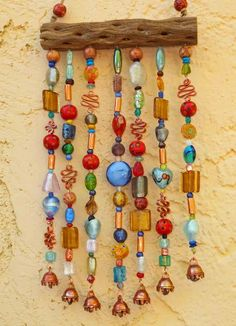 Clark Hamblen and Christie, thought of you when I saw this wind chime. Blowin' In The Wind, Diy Wind Chimes, Driftwood Art, Fence Art, Sun Catcher, Drift Wood, Beads And Wire, Dream Catchers, Yard Art