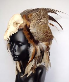 Animal Skull Feather Headress by MissGDesignsShop on Etsy, $380.00  Or you could make your own.  Shaman headdress.