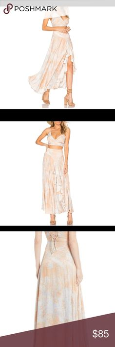 Free People Gardenia set-NWT Free People set with cropped top and Maxi skirt with ruffle detail. I bought this on Posh but it doesn't fit me🙁 color is an off white- gray and peach. Very cute outfit!! My loss is your gain! Please see additional pics for details. Please no low ball offers 🙅🏻‍♀️ Free People Skirts Skirt Sets
