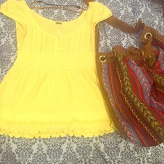 Free People Yellow Knit Top Sz Small A soft yellow color free people knit top. Cap sleeves, 1/4 button down, and frilly bottom. Used, but no flaws or stains. Size small. Free People Tops