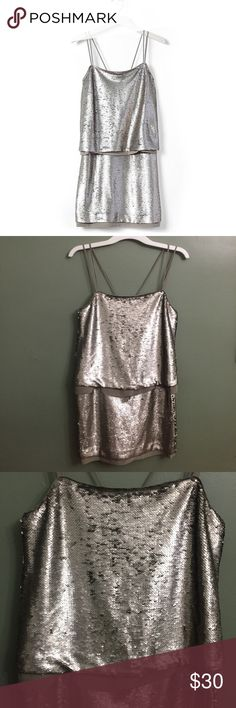 """NWOT Banana Republic Strappy Sequin Dress, 2 NWOT Banana Republic Strappy Sequin Dress, 2. Features shimmering sequins, a layered cutout back, rear zip closure, double spaghetti straps. Measures approximately 34"""" in length, and 15.5"""" from left armpit across. First photo is a stock photo. There are pin holes on the lining fabric where the original tags were. Banana Republic Dresses"""
