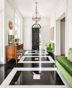 Accents of green with the black granite and white marble floor make a statement in this chic entry foyer. Accents of green with the black granite and white marble floor make a statement in this chic entry foyer. Floor Design, Tile Design, Sofa Design, House Design, Design Design, Design Ideas, Furniture Design, Graphic Design, Foyer Flooring