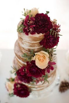 Adorn a naked cake with jewel-toned flowers.