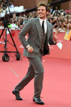 Thanks to his recent round of premieres for his current rom-com Love, Rosie, the actor's become something of a regular in our Most Stylish lists. This week is no exception, with Sam showing how to pull-off big-lapelled windowpane checks in Rome, courtesy of Dolce & Gabbana. Vote for Sam Claflin to win the GQ Best-Dressed Man 2015 Readers' Vote.