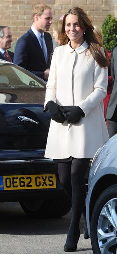 "Catherine Duchess of Cambridge, aka Kate Middleton, wearing the ""Redgrave"" coat by Goat, Contrast Color Dress by Topshop, and Episode 'Angel' heels in black suede. Visiting the Child Bereavement UK headquarters in Saunderton, Buckinghamshire, 3/19/13."