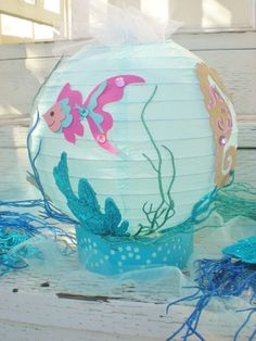 Under the Sea table centerpiece beach or ocean theme fish seahorse clam shell and starfish with LED light 10 diameter Little Mermaid Birthday, Little Mermaid Parties, The Little Mermaid, Octonauts Party, Mermaid Baby Showers, Under The Sea Theme, Ocean Themes, Paper Lanterns, Birthday Decorations