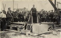Mayor T.L. Church laying the foundation stone for the Coliseum at the CNE in 1921. Seated are members of the Winter Fair Board and the City Council.