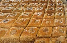 In this baklava recipe flavored with orange flower water, an almond filling is baked between layers of homemade pastry and garnished with syrup or honey.