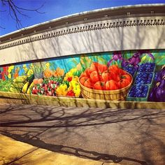 The Farmers Market Mural by Conrad Kaufman colorfully displays the bountiful supply of produce in Van Buren County. The mural is located near Dyckman Park in downtown #SouthHaven facing the South Haven Farmers Market and our office! Thanks for sharing Instagram user veanez!