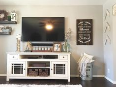Living Room Decor, Farmhouse Style, Farmhouse Decor, farmhouse living room, farmhouse tv decor, Modern Farmhouse,   Painted Mason Jars, Tv Console Decor, White tv console, galvanized tin, tv decor, demijohn bottle, tv console storage? See Instagram photos and videos from Robin Norton (@rocknrob)