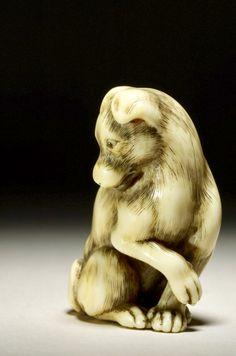 DescriptionIvory netsuke. Sitting dog with paw raised. Producer nameMade by: Yamaguchi Okatomo 山口岡友 biography Production placeMade in: Japan term details(Asia,Japan)