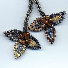 Russian Leaves Lariat (detail) by Jeka Lambert. Seed Bead Necklace, Seed Bead Jewelry, Beaded Earrings, Beaded Jewelry, Beaded Bracelets, Necklaces, Jewellery, Fabric Beads, Jewelry Patterns