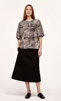 b7b20613c4c3f The off-white and black Kubb print of undulating lines decorates the  loose-fitting Vehka top
