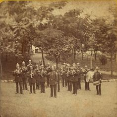 Brass band performing at Schnaider's Beer Garden. Chouteau Avenue between Mississippi and Armstrong. (1870) Missouri History Museum