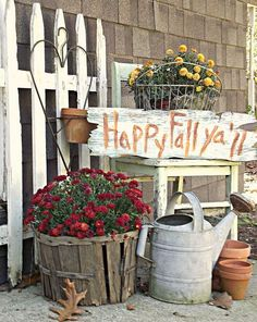 Great way to use old harvest baskets and metal baskets, old watering cans, etc.