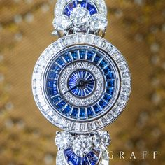 Graff's Fancy MoonLight timepiece features a flowing radial design set with rich sapphires representing the night sky, and diamonds illustrating the shadows that the moon casts over the earth. Graff Jewelry, High Jewelry, Jewellery, Trendy Watches, Watches For Men, Expensive Watches, Seiko Watches, Beautiful Watches, Quartz Watch