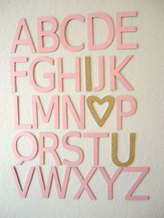 These adorable pink and gold alphabet letters are handmade with 1/8 wood and cardstock paper that has been modpodged on. They hang flat against the