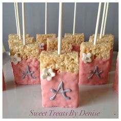 Rice Krispy treats on a stick with a monogram for a baby shower or even bridal shower.