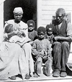"""This unidentified slave family is labeled on the original caption of this photograph, which dates from the 1850s, as ""Uncle Tom and family""."""