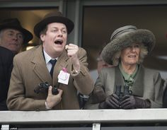 Victory! Tom Parker-Bowles cheers on his horse, while his mother concedes defeat...