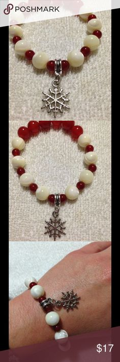 Red and White Winter Snowflake Gemstone Bracelet This beautiful piece is made with natural carnelian stones and gorgeous mother of pearl and features a silver tone snowflake charm. It is elastic, so one size fits all. This bracelet and all PeaceFrog jewelry items are made by me! Take a look through my boutique for coordinating jewelry and more unique creations. PeaceFrog Jewelry Bracelets