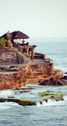 The breathtaking Tanah Lot Sea Temple is perched atop an enormous rock.