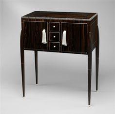 "Émile-Jacques Ruhlmann, ""Fuseaux"" Cabinet, ca. 1925, macassar ebony, ivory, silk, silvered bronze. The Metropolitan Museum of Art, Purchase, Edward C. Moore Jr. Gift. Image © The Metropolitan Museum of Art."