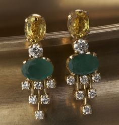 Gehna offer to showcasing handcraft earrings online in Chennai - A classic pair of earrings showcasing diamonds, emeralds and citrines is handcrafted in gold. Gold Jhumka Earrings, Gold Earrings Designs, Emerald Earrings, Jhumka Designs, Bridal Earrings, Hoop Earrings, Gold Jewelry Simple, Stylish Jewelry, Ear Jewelry